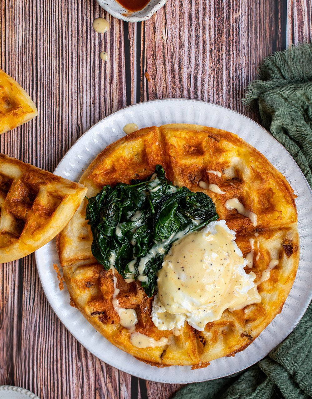 eggs florentine on bacon and cheese waffles