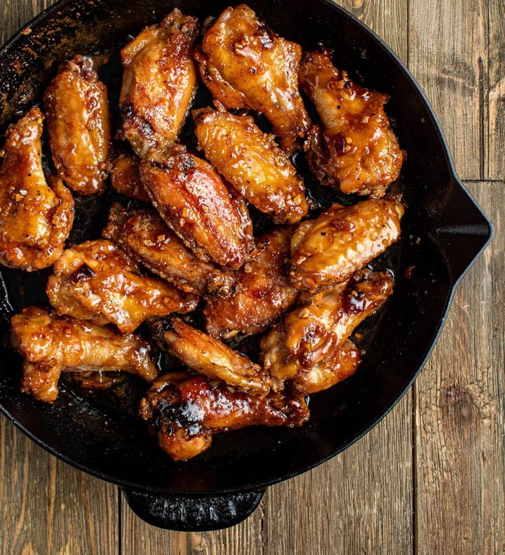 toss chicken wings in sauce
