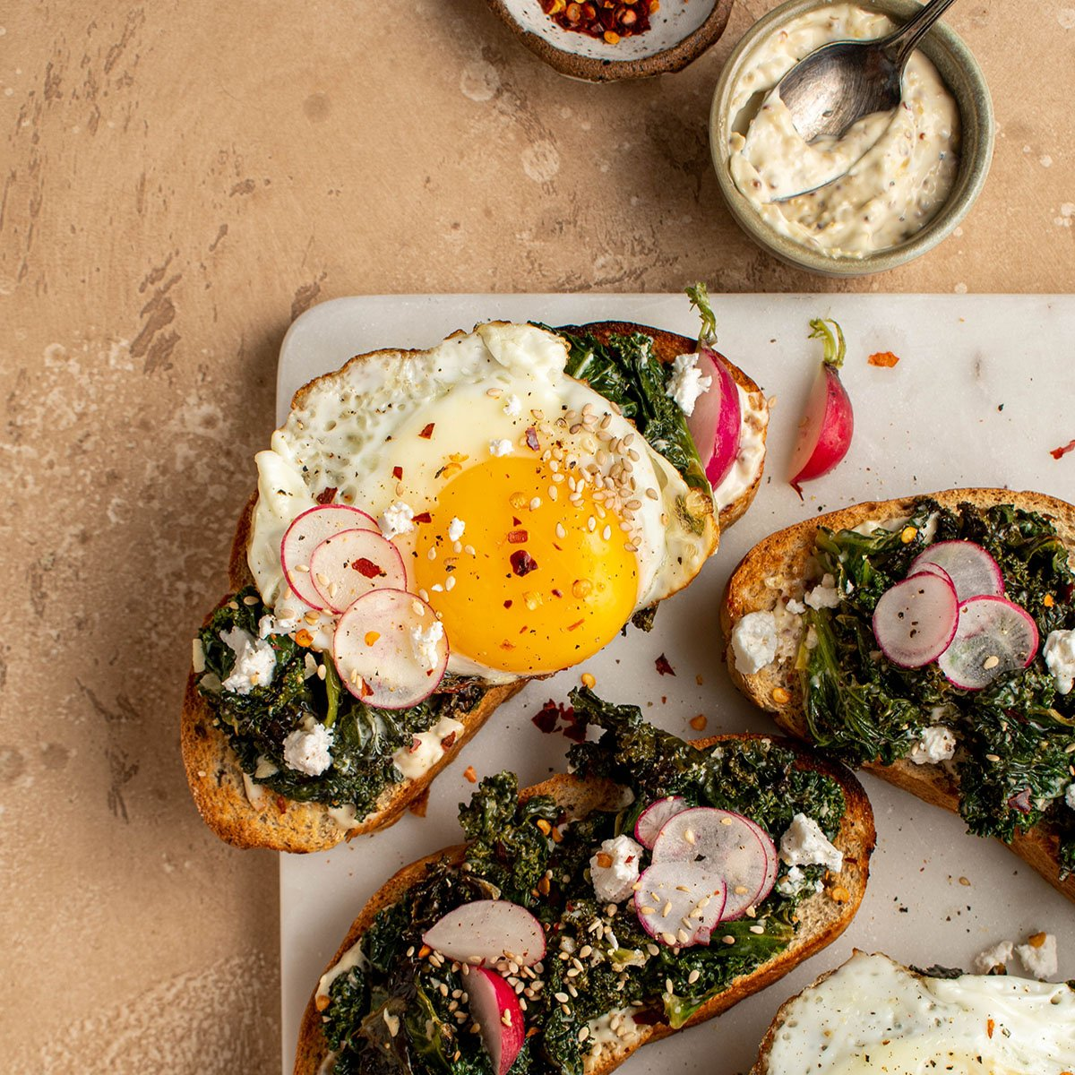 fried egg tartine with braised kale