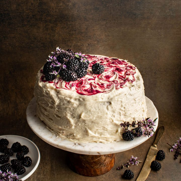 decorate cake with honey buttercream and blackberry curd